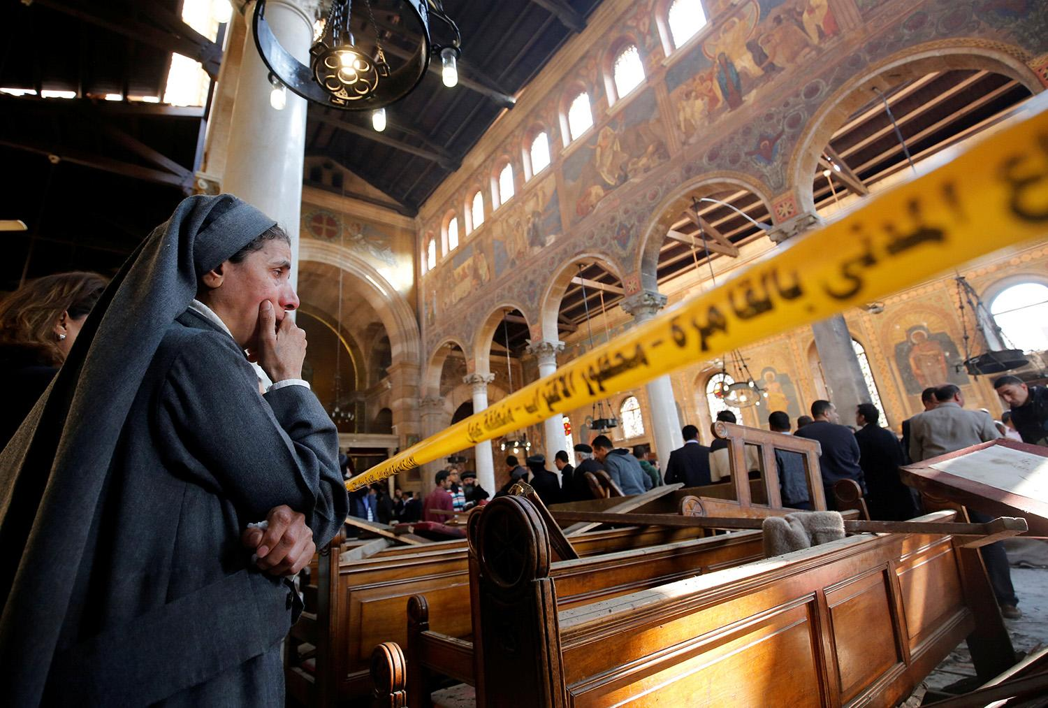 <p>A nun cries as she stands at the scene inside Cairo's Coptic cathedral, following a bombing, in Egypt Dec. 11, 2016. (Photo: Amr Abdallah Dalsh/Reuters) </p>