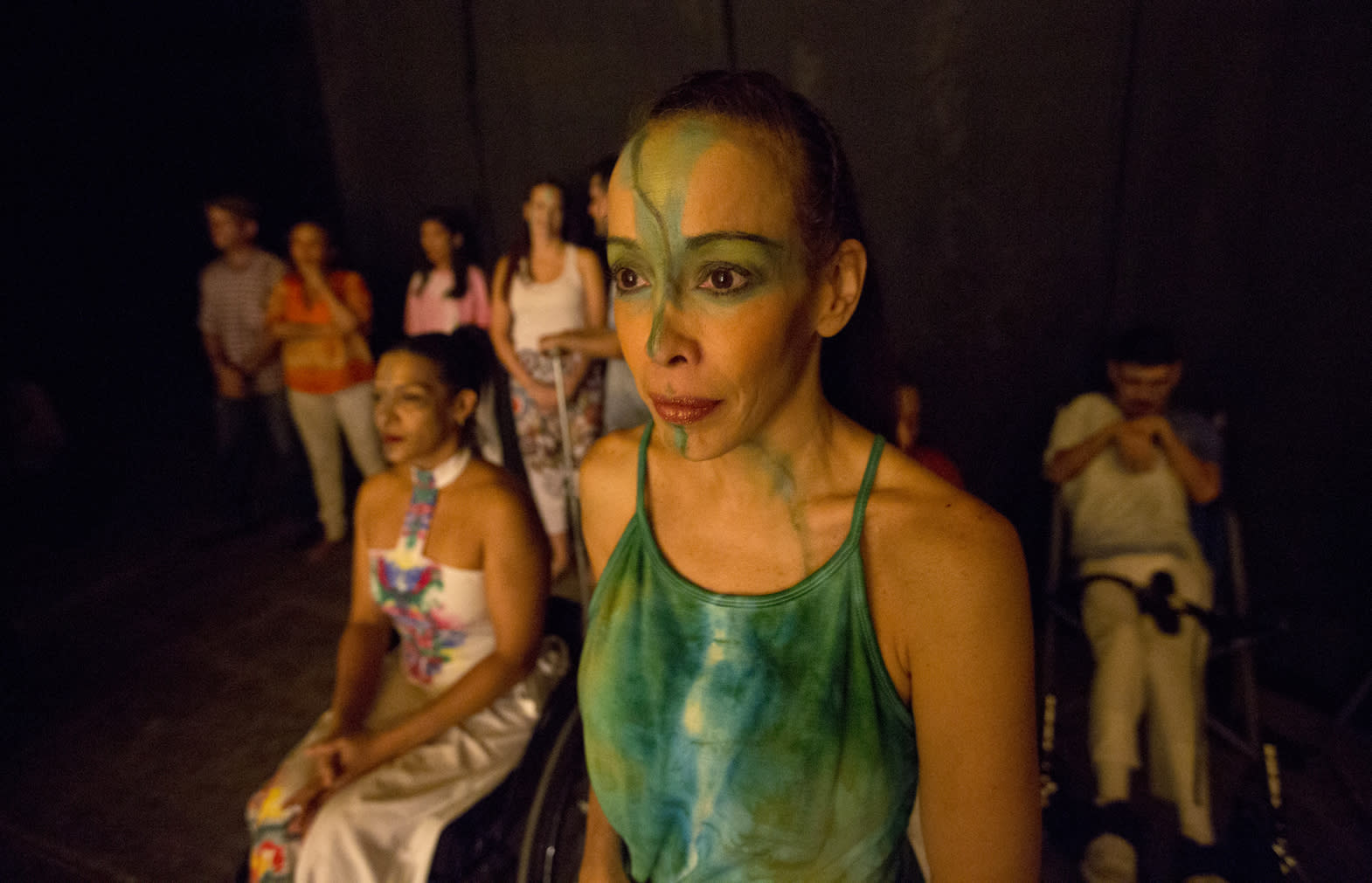 In this Dec. 4, 2018 photo, dancers watch their fellow dancers perform in the contemporary dance production Ubuntu, at the Teresa Carreno Theater in Caracas, Venezuela. During the show, disabled dancers perform alongside fully abled professional dancers to demonstrate that art knows no barriers. (AP Photo/Fernando Llano)