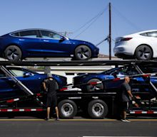 Tesla Buys Trucking Companies to Boost Deliveries,MuskSays