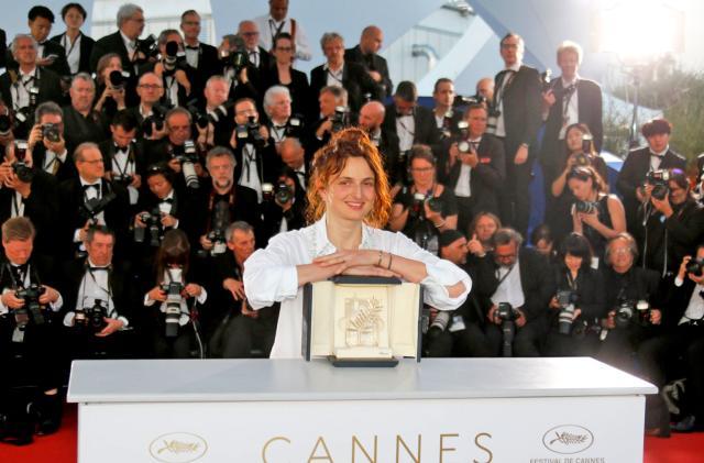 Netflix snaps up two Cannes award winners despite feud