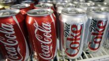 Coca-Cola Amatil's spending hits shares