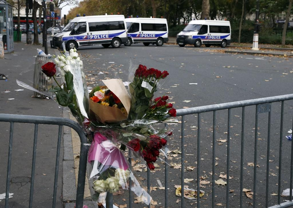 A floral tribute for the victims of the terror attacks is left near the Bataclan theatre in the 11th district of Paris, on November 14, 2015