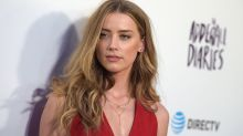 Amber Heard Enjoys a Night Out With Cara Delevingne and Margot Robbie in London After Divorce Settlement