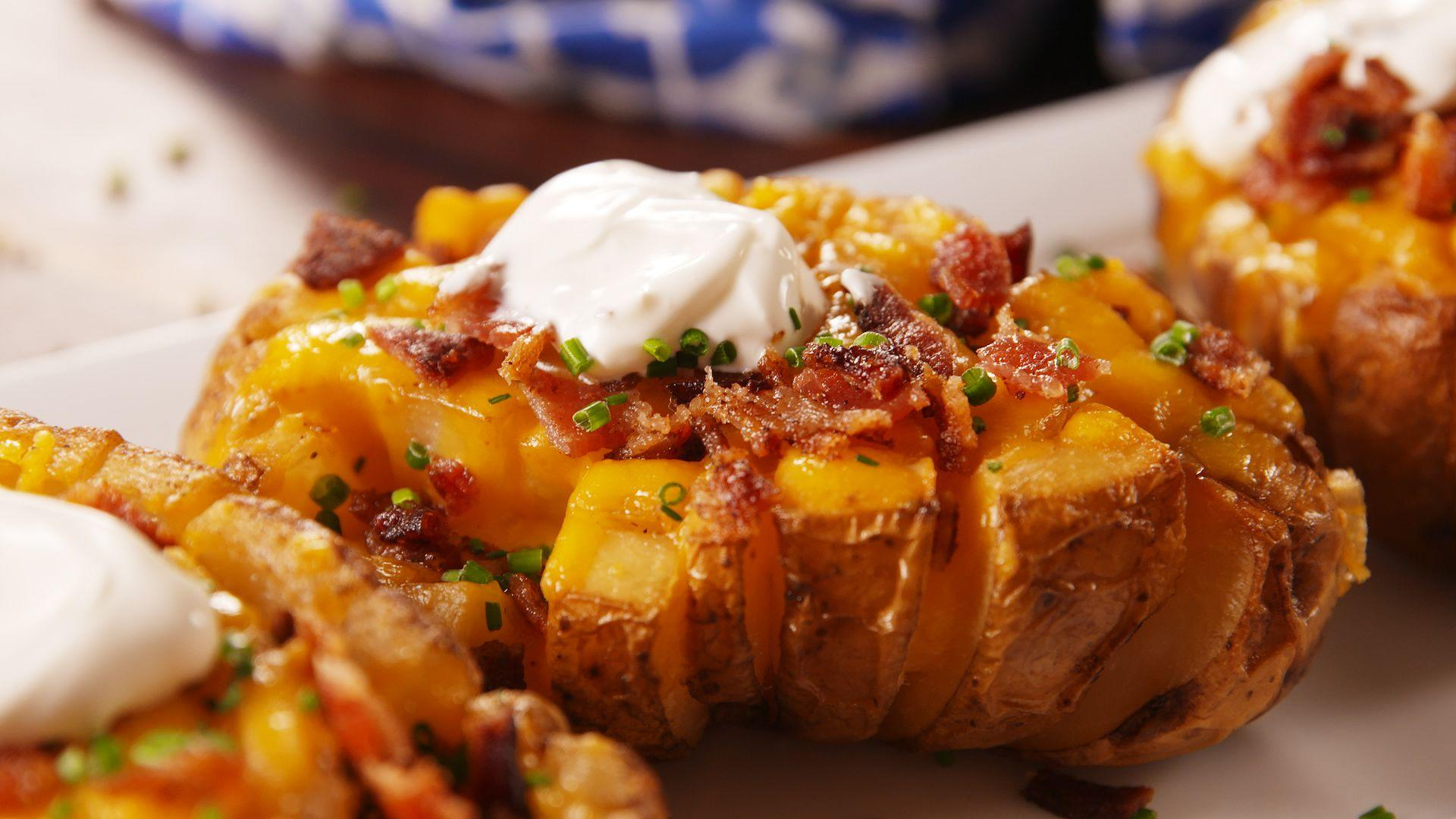 "<p>First thing's first: Here's <a href=""https://www.delish.com/cooking/recipe-ideas/a20533565/how-to-bake-a-potato/"" rel=""nofollow noopener"" target=""_blank"" data-ylk=""slk:the best way to bake a potato"" class=""link rapid-noclick-resp"">the best way to bake a potato</a>. Once you've got that covered, quit <em>only</em> topping them with sour cream and calling it a day. There's a world of options out there, from turning them into a breakfast boat to stuffing them with buffalo chicken. Plus, try our <span>amazing twice baked potatoes</span> and <span>genius baked potato toppings</span>!</p>"