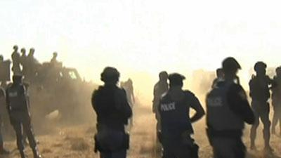 Raw Video: S. African police open fire on miners