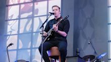 George Ezra performs Isle of Wight headline slot sat down - after hurting ankle running before the gig