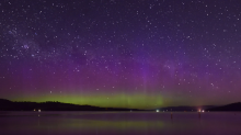 Timelapse Captures Shooting Stars Streaking Over Aurora-Filled Night Sky