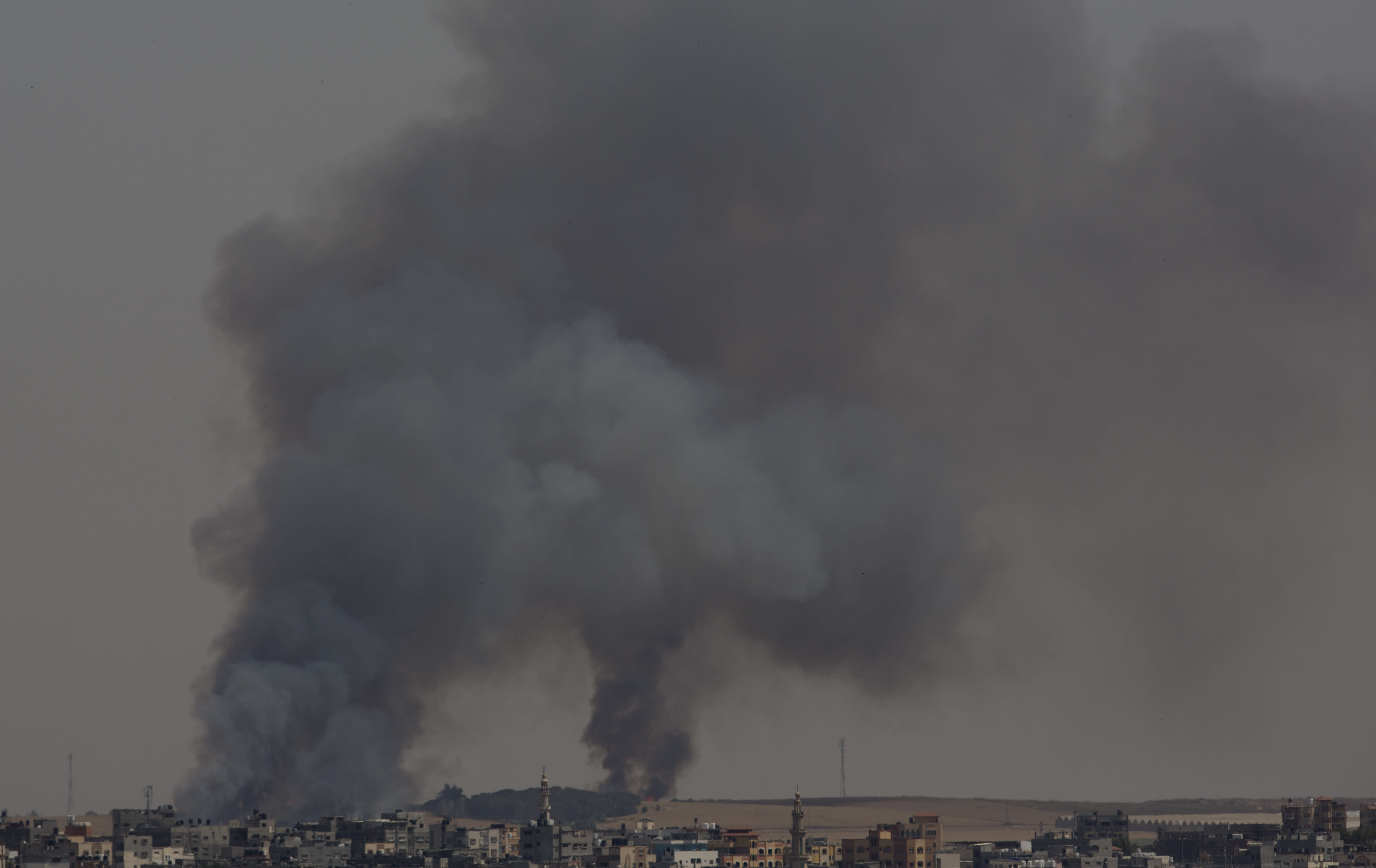 """Smoke rises from fires on Israeli farmland caused by arson balloons launched from Gaza City, Wednesday, May 15, 2019. Palestinians are marking the 71st anniversary of their mass displacement during the 1948 war around Israel's creation. Demonstrations were held across the Israeli-occupied West Bank and the Gaza Strip on Wednesday to mark what the Palestinians call the """"nakba,"""" or """"catastrophe."""" (AP Photo/Hatem Moussa)"""
