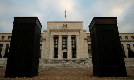 Bollards help secure the entrance to the Federal Reserve in Washington, December 16, 2015. REUTERS/Kevin Lamarque