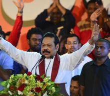 Sri Lanka's Rajapakse vows to hold polls despite challenge