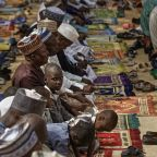 The Latest: Nigeria delays presidential vote until Feb. 23