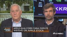 Apple-Qualcomm suit weighs on Apple's stock
