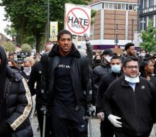 'Racism is a pandemic': Anthony Joshua on crutches as he marches in Black Lives Matter protest