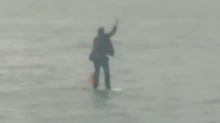 Man in Suit Paddleboards to Work Across New York's Hudson River