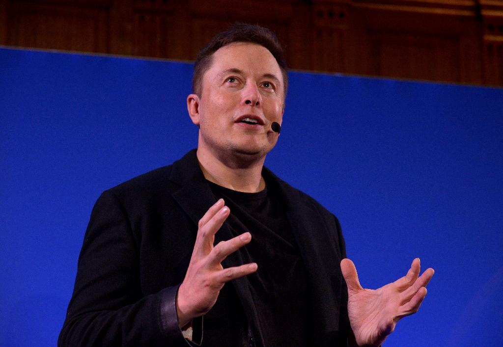 Elon Musk showed a futuristic video depicting his ideas for an interplanetary transport system based on re-usable rockets, a propellant farm on Mars and 1,000 spaceships on orbit, carrying about 100 people each (AFP Photo/Eric Piermont)