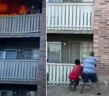 Incredible video shows a former US Marine making a split-second dive to rescue a toddler from a burning building