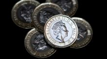 Britain's new 12-sided pound coin enters circulation