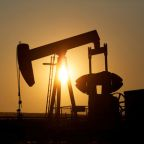 Crude rises slightly despite oversupply fears