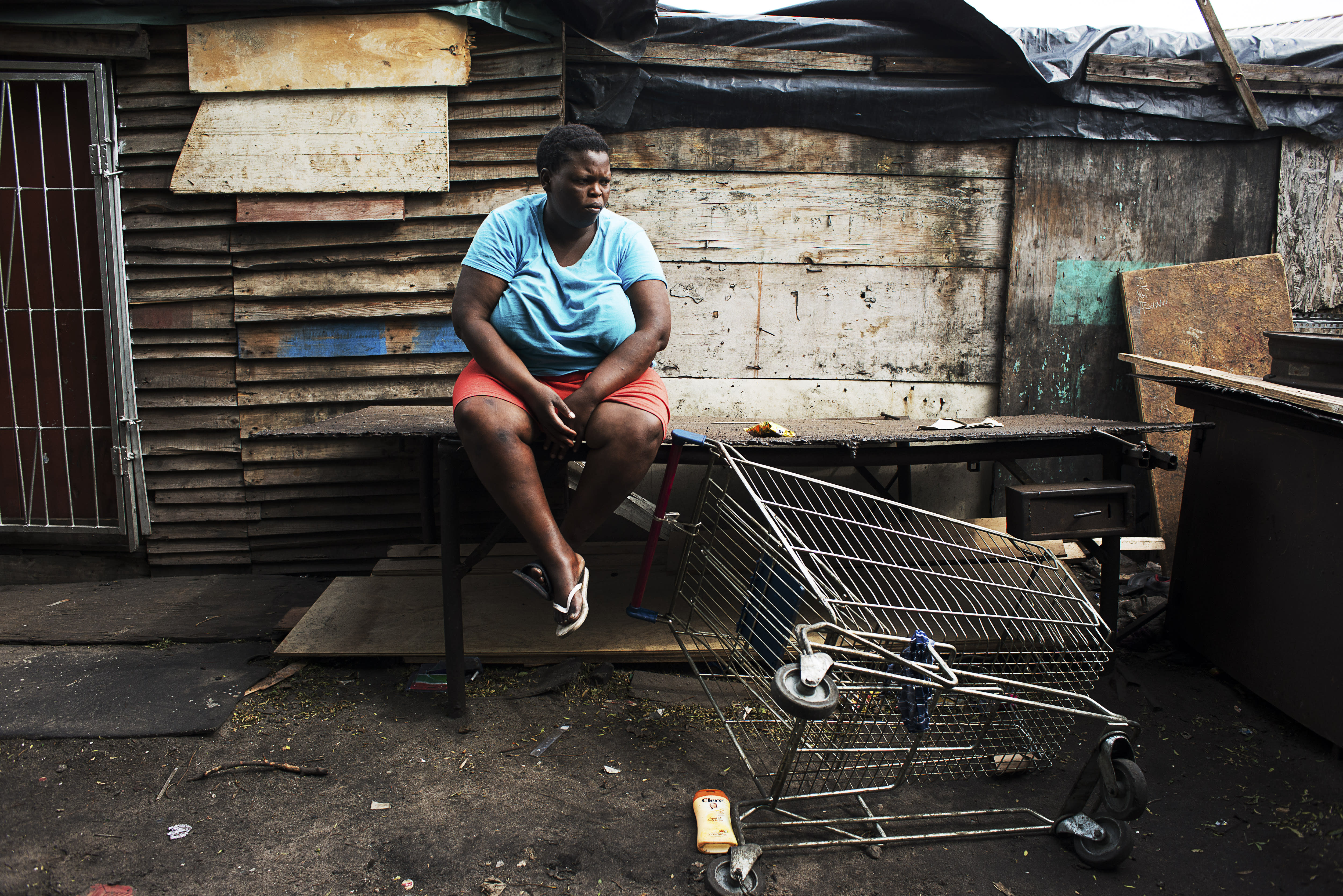 <p>A girl suffering from obesity sits in front of her house in the Langa township, a poor suburb of Cape Town. Obesity in South Africa affects more women than men: 69.3 per cent of South African women have unhealthy levels of body fat and more than four in 10 are clinically obese. (Photograph by Silvia Landi) </p>