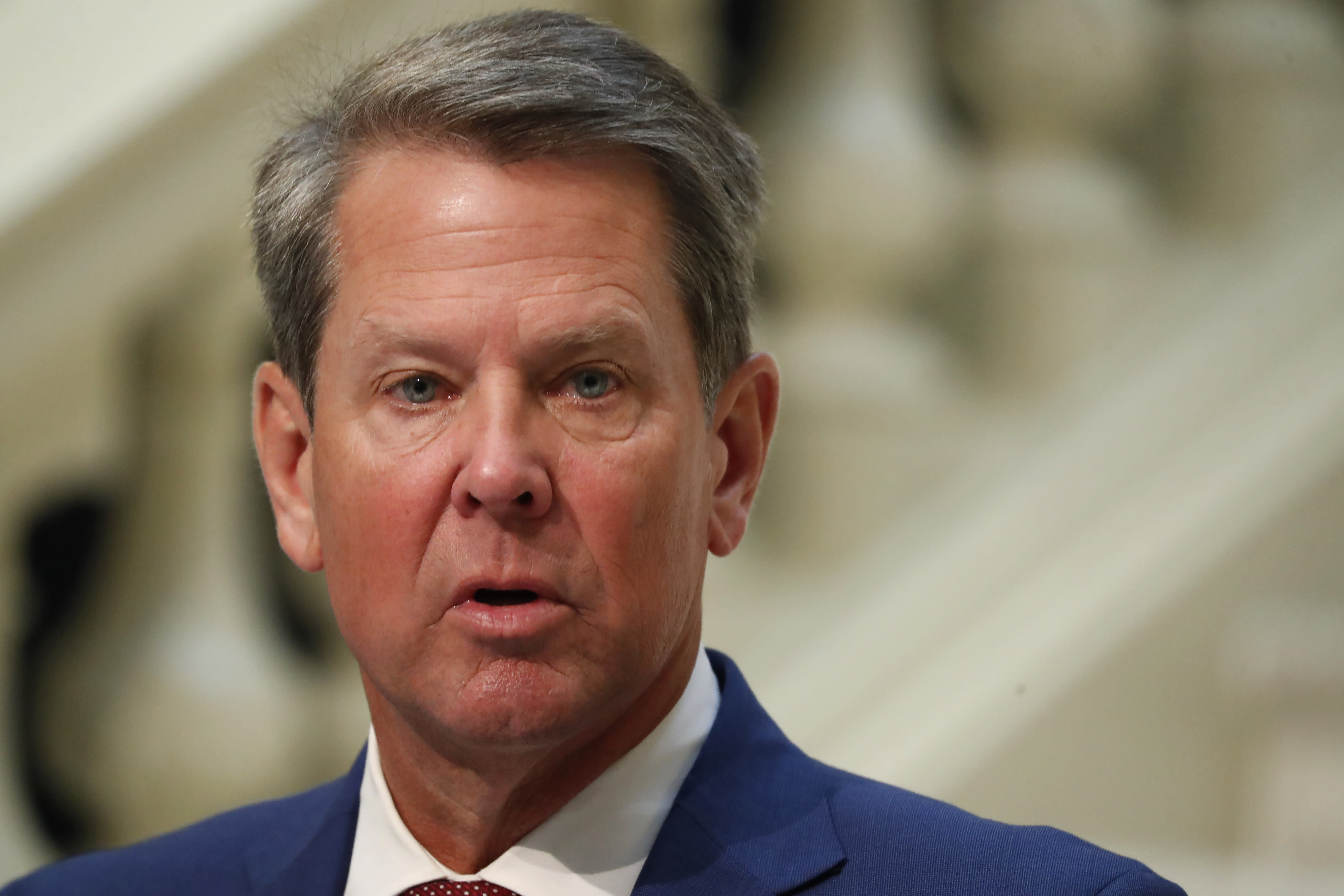 FILE-In this Friday, July 17, 2020 file photo, Georgia Gov. Brian Kemp speaks during a coronavirus briefing at the Capitol, in Atlanta. Kemp on Thursday, Aug. 13, said he's dropping a lawsuit against the city of Atlanta in a dispute over the city's requirement to wear masks in public and other restrictions related to the COVID-19 pandemic. (AP Photo/John Bazemore, File)