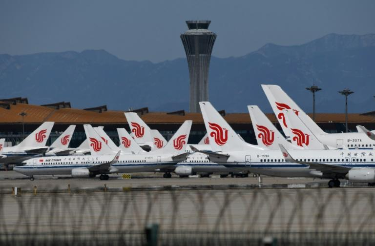 More than 1,200 flights to and from Beijing's main airports were cancelled over coronavirus worries (AFP Photo/GREG BAKER)