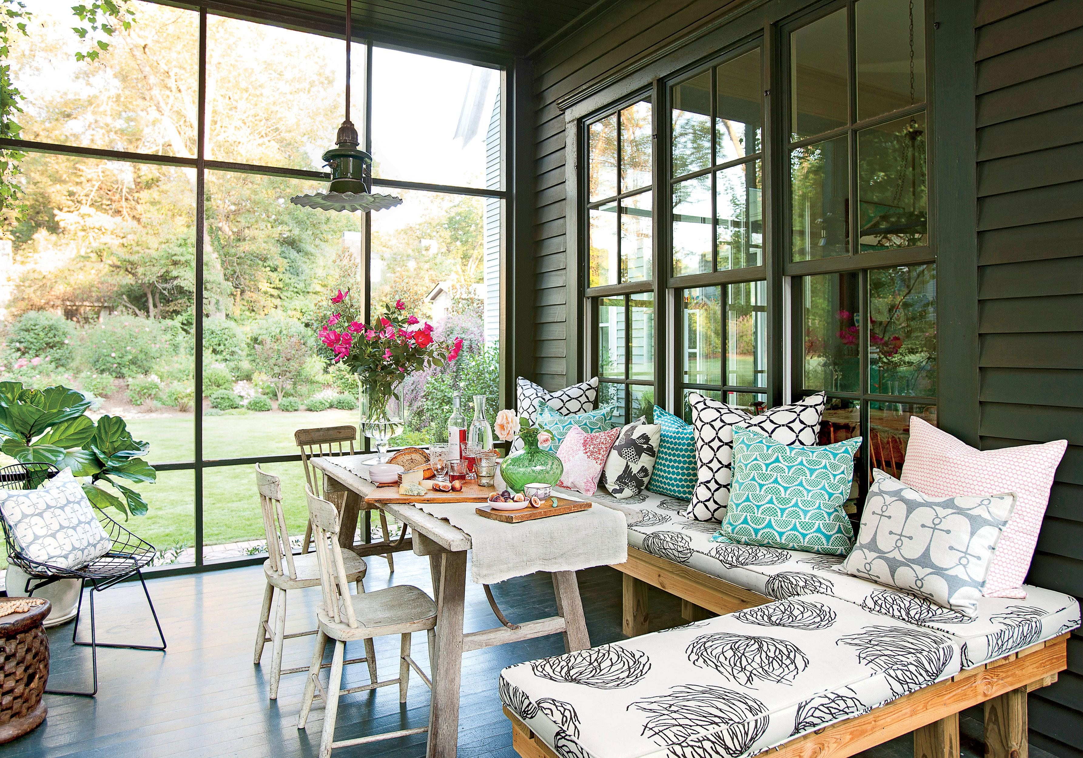 <p>A small table in the center of this screened-in porch serves as the focal point. It's right off the kitchen making it a great spot for overflow when entertaining.</p>