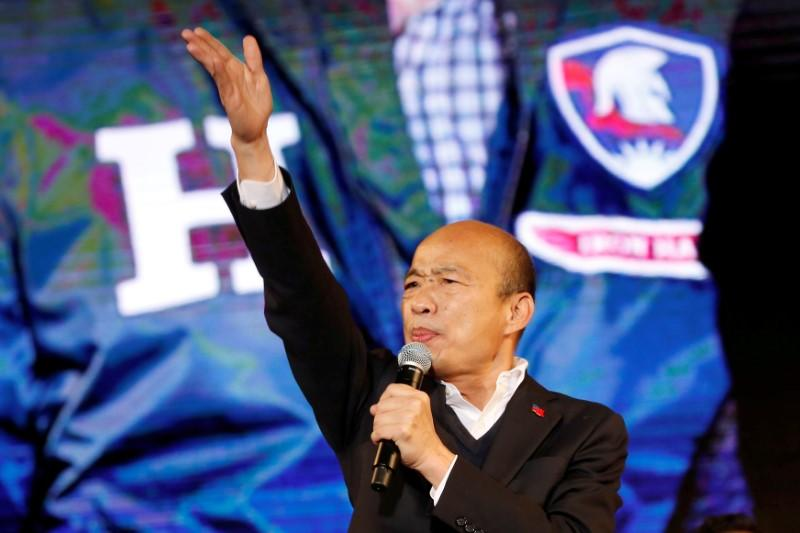 FILE PHOTO: Kuomintang party's presidential candidate Han speaks to his supporters at an election rally in Taichung