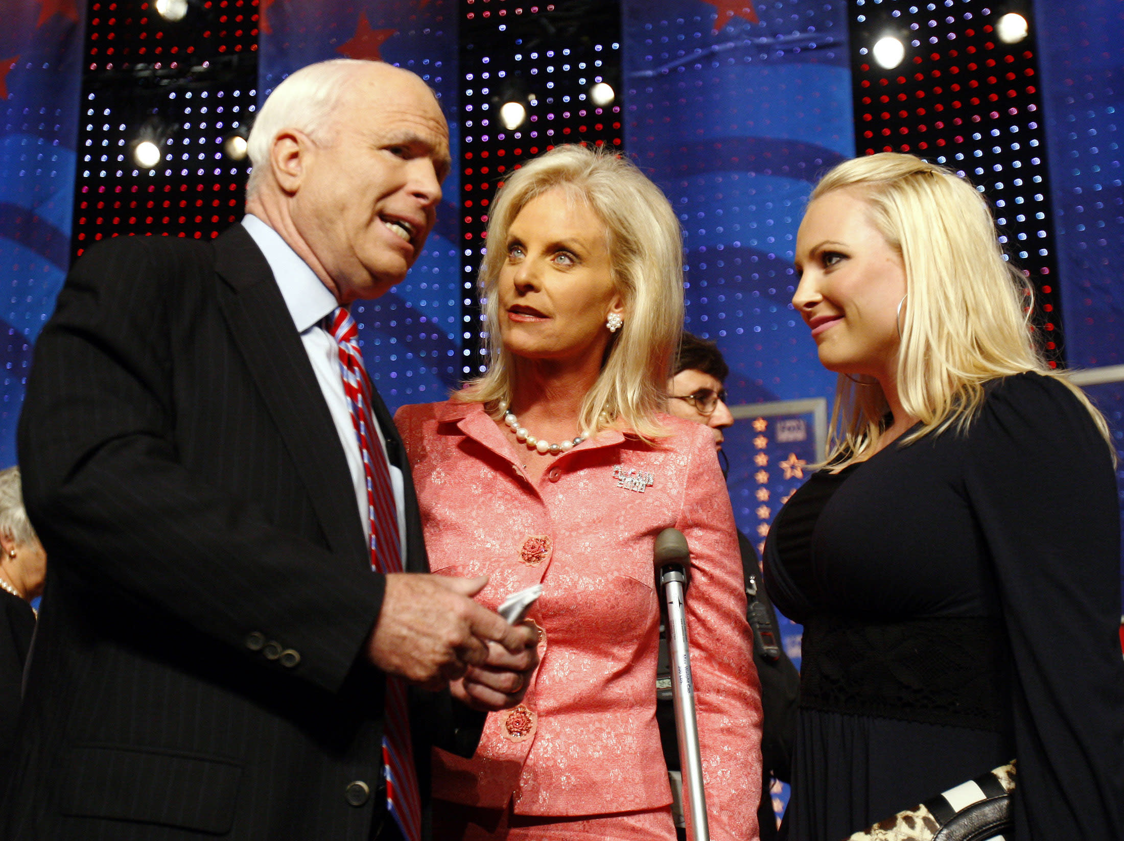 Republican presidential candidate U.S. Senator John McCain (R-AZ) is joined onstage by his wife Cindy (C) and daughter Meghan (R) following a debate among the Republican presidential candidates at the University of New Hampshire in Durham,New Hampshire, September 5, 2007. REUTERS/Brian Snyder (UNITED STATES)