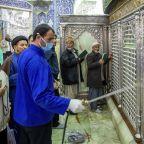 Iranian clerics keep shrines open, even as virus spreads