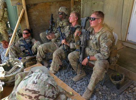 U.S. military advisers from the 1st Security Force Assistance Brigade sit at an Afghan National Army base in Maidan Wardak province, Afghanistan August 6, 2018. REUTERS/James Mackenzie