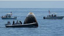 Nasa SpaceX crew return: Dragon capsule splashes down
