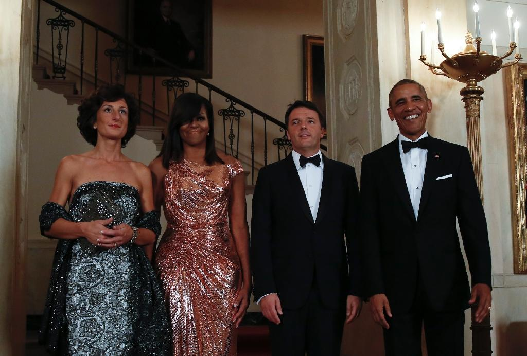US First lady Michelle Obama (2nd left) wore a Versace gown for a State Dinner at the White House in Washington, on October 18, 2016 (AFP Photo/Yuri Gripas)
