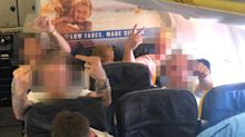 Airline staff accused of doing 'nothing' after woman called homophobic slurs, 'miserable b***h' by male passengers