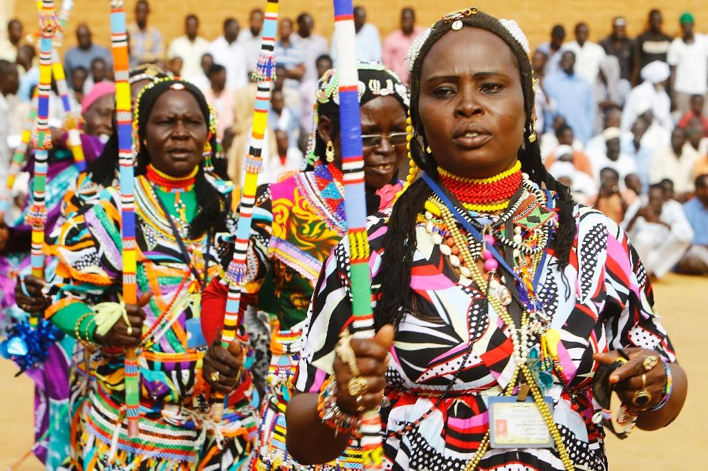 Members of Sudan's Nuba community perform a traditional dance during the Nuba Mountains Cultural Heritage Festival, marking the International Day of the World's Indigenous Peoples in the capital's twin city of Omdurman, Sudan on August 15, 2015 (AFP Photo/Ashraf Shazly)
