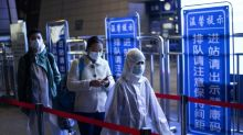 China lifts Wuhan travel ban, Britain, NY report record deaths