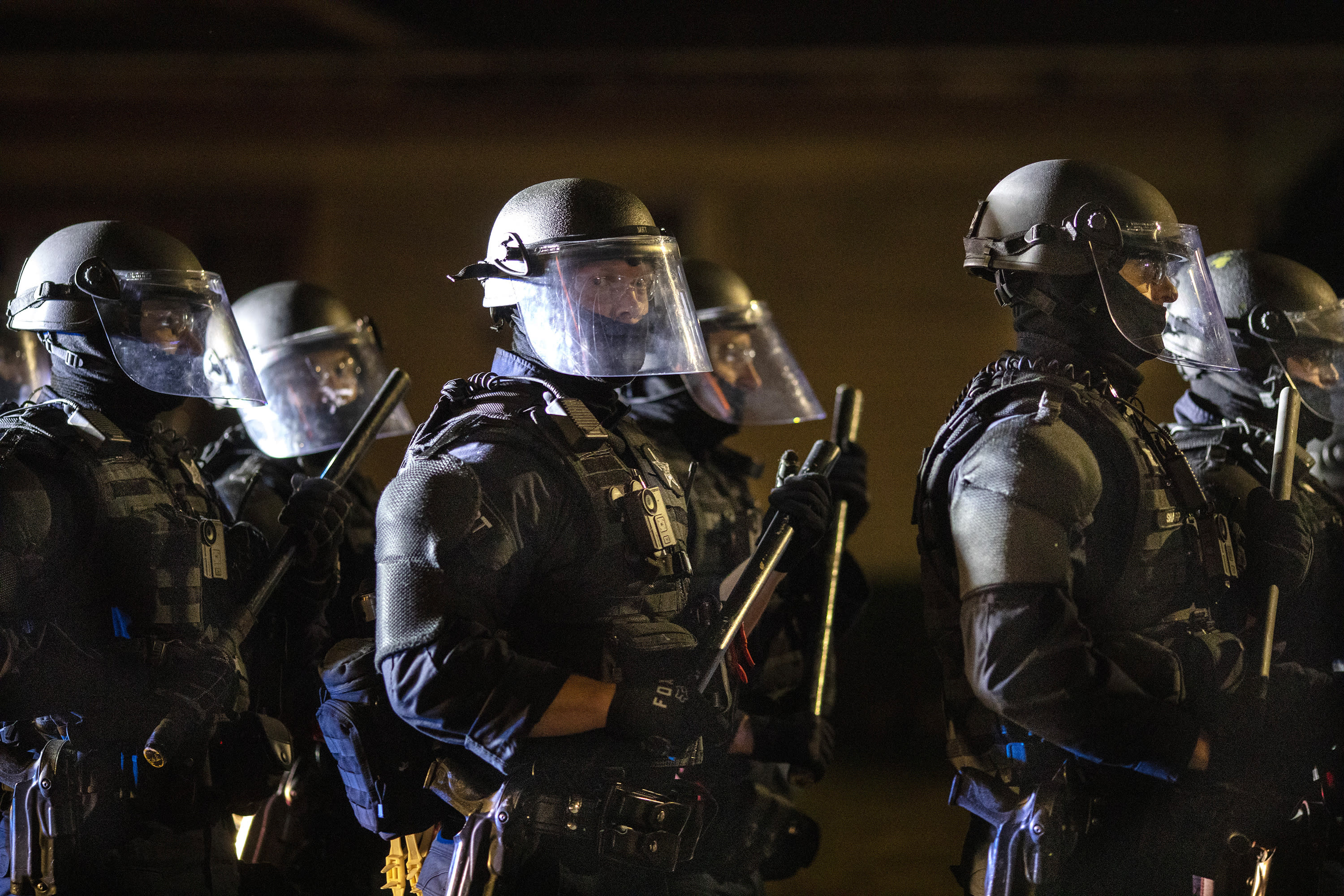 Portland police take control of the streets after making arrests on the scene of the nightly protests at a Portland police precinct on Sunday, Aug. 30, 2020 in Portland, Ore. Oregon State Police will return to Portland to help local authorities after the fatal shooting of a man following clashes between President Donald Trump supporters and counter-protesters that led to an argument between the president and the city's mayor over who was to blame for the violence. (AP Photo/Paula Bronstein)