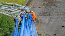 In Pictures: Work to repair damaged reservoir continues one year on