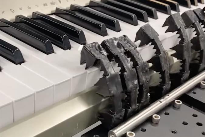 Soft robot playing the piano using pneumatic memory