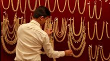 Gold falls as hopes of U.S. tax reform boost riskier assets