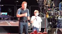 Springsteen shares spotlight with young fan