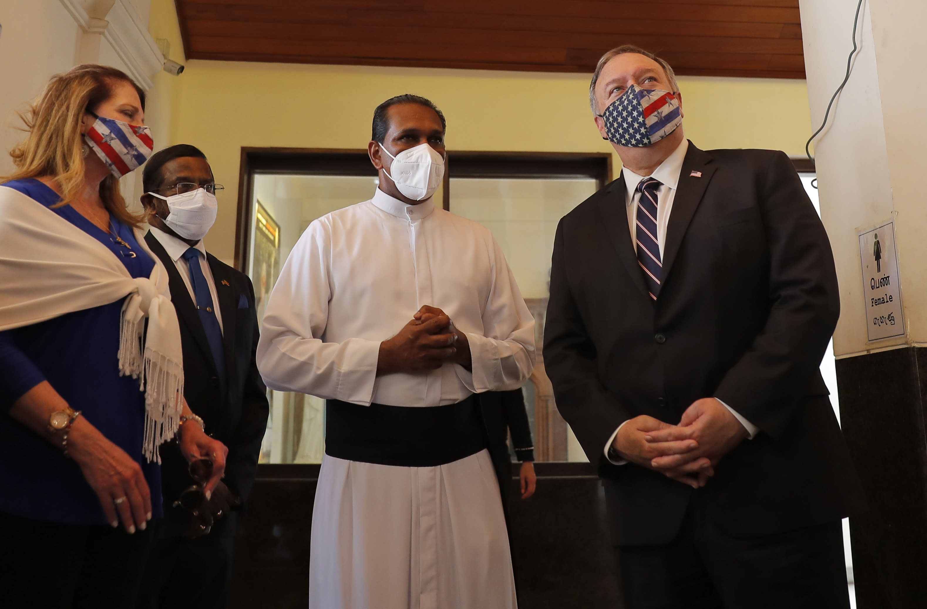 U.S. Secretary of State Mike Pompeo visits St. Anthony's church, one of the sites of the 2019 Easter Sunday attacks, in Colombo, Sri Lanka, Wednesday, Oct. 28, 2020. Pompeo plans to press Sri Lanka to push back against Chinese assertiveness, which U.S. officials complain is highlighted by predatory lending and development projects that benefit China more than the presumed recipients. The Chinese Embassy in Sri Lanka denounced Pompeo's visit to the island even before he arrived there, denouncing a senior U.S. official's warning that the country should be wary of Chinese investment. (AP Photo/Eranga Jayawardena, Pool)