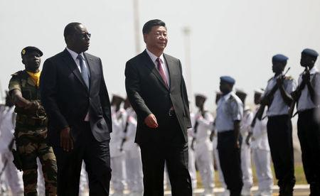 Chinese President Xi Jinping walks with Senegal's President Macky Sall after arriving at the Leopold Sedar Senghor International Airport, at the start of his visit to Dakar, Senegal July 21, 2018. REUTERS/Mikal McAllister