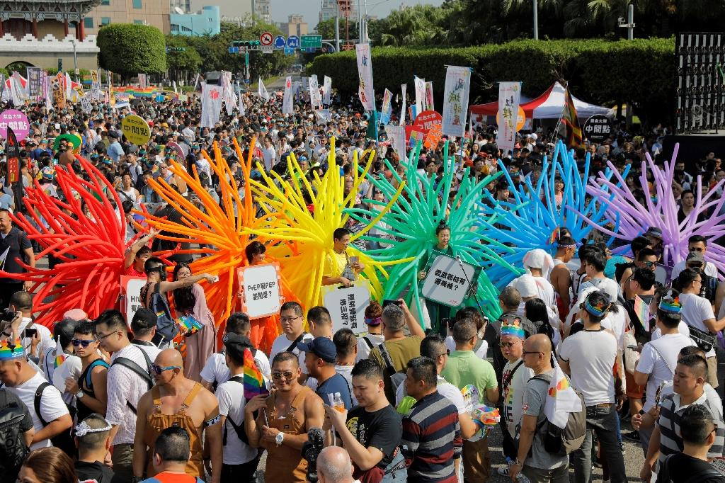 """Opponents warn that """"forcefully"""" passing a gay marriage law will intensify tensions (AFP Photo/Daniel Shih)"""