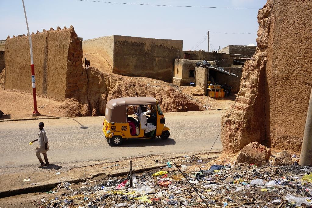 Those wanting to protect the city's unique heritage are appealing for fresh funding to shore up the walls before it is too late (AFP Photo/AMINU ABUBAKAR)
