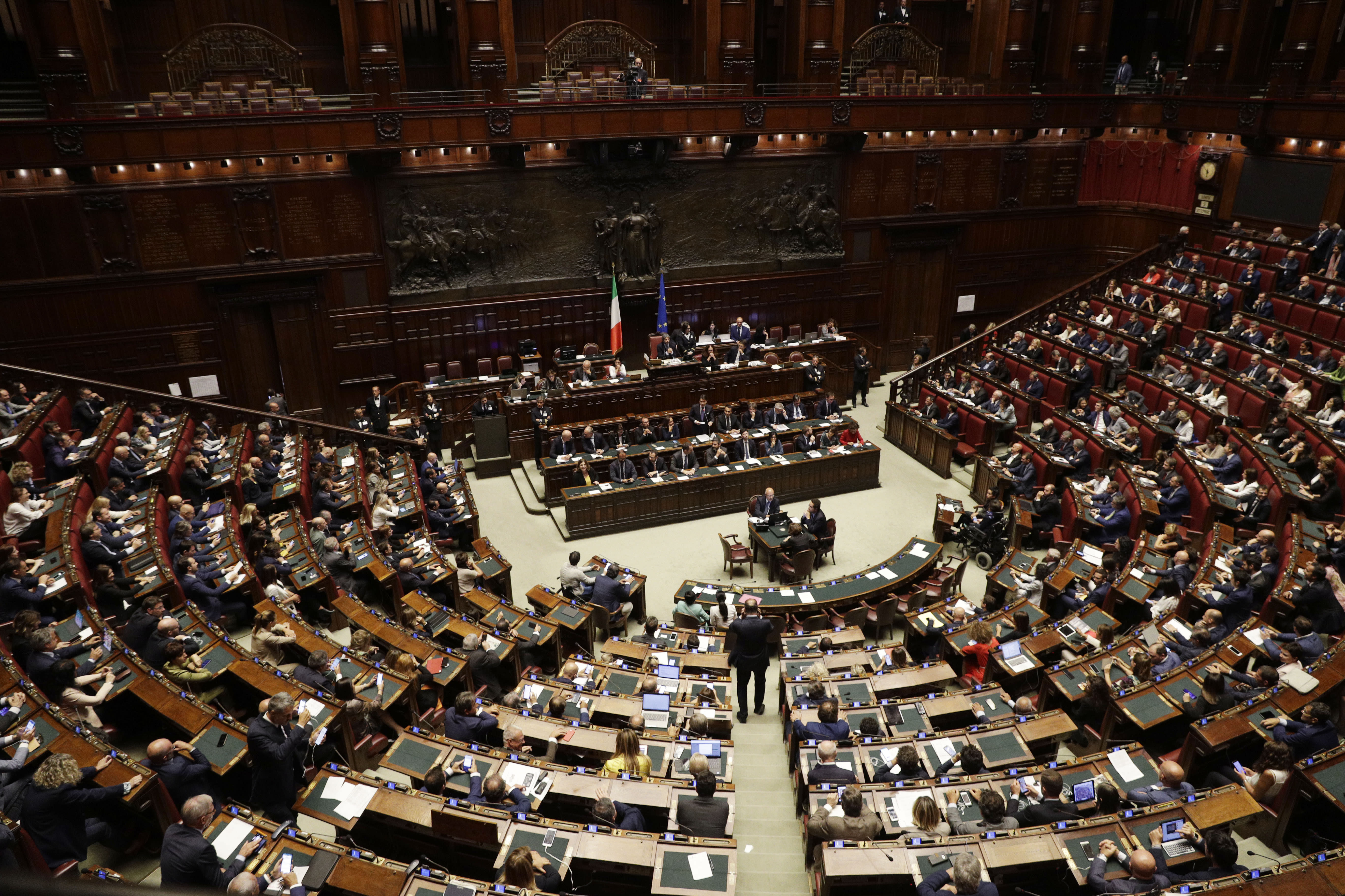 Italian Premier Giuseppe Conte, center, intervenes in the parliament debate ahead of confidence vote later at the Lower Chamber in Rome, Monday, Sept. 9, 2019. Conte is pitching for support in Parliament for his new left-leaning coalition ahead of crucial confidence votes. (AP Photo/Gregorio Borgia)