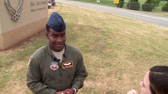 Video of U S  airman helping 71-year-old woman with a walker and carrying  groceries goes viral: 'Don't let anyone be forgotten'