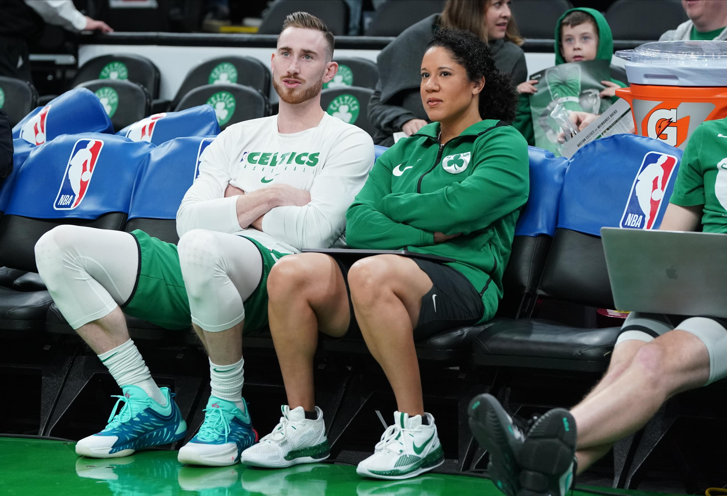 Kara Lawson watches from the sidelines with Gordon Hayward during her time as a Celtics assistant