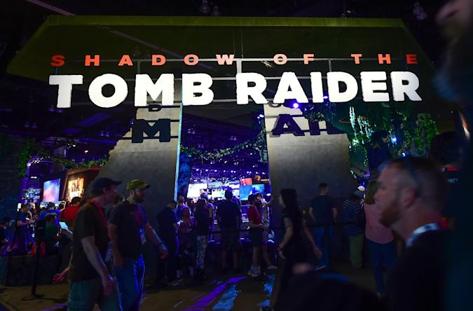 People wait in line to play the video game Shadow of the Tomb Raider,  by Eidos Montreal and Square Enix, on June 12, 2018 at the 24th Electronic Expo, or E3 2018, in Los Angeles, California where hardware manufacturers, software developers and the video game industry present their new games. (Photo by Frederic J. BROWN / AFP)        (Photo credit should read FREDERIC J. BROWN/AFP/Getty Images)