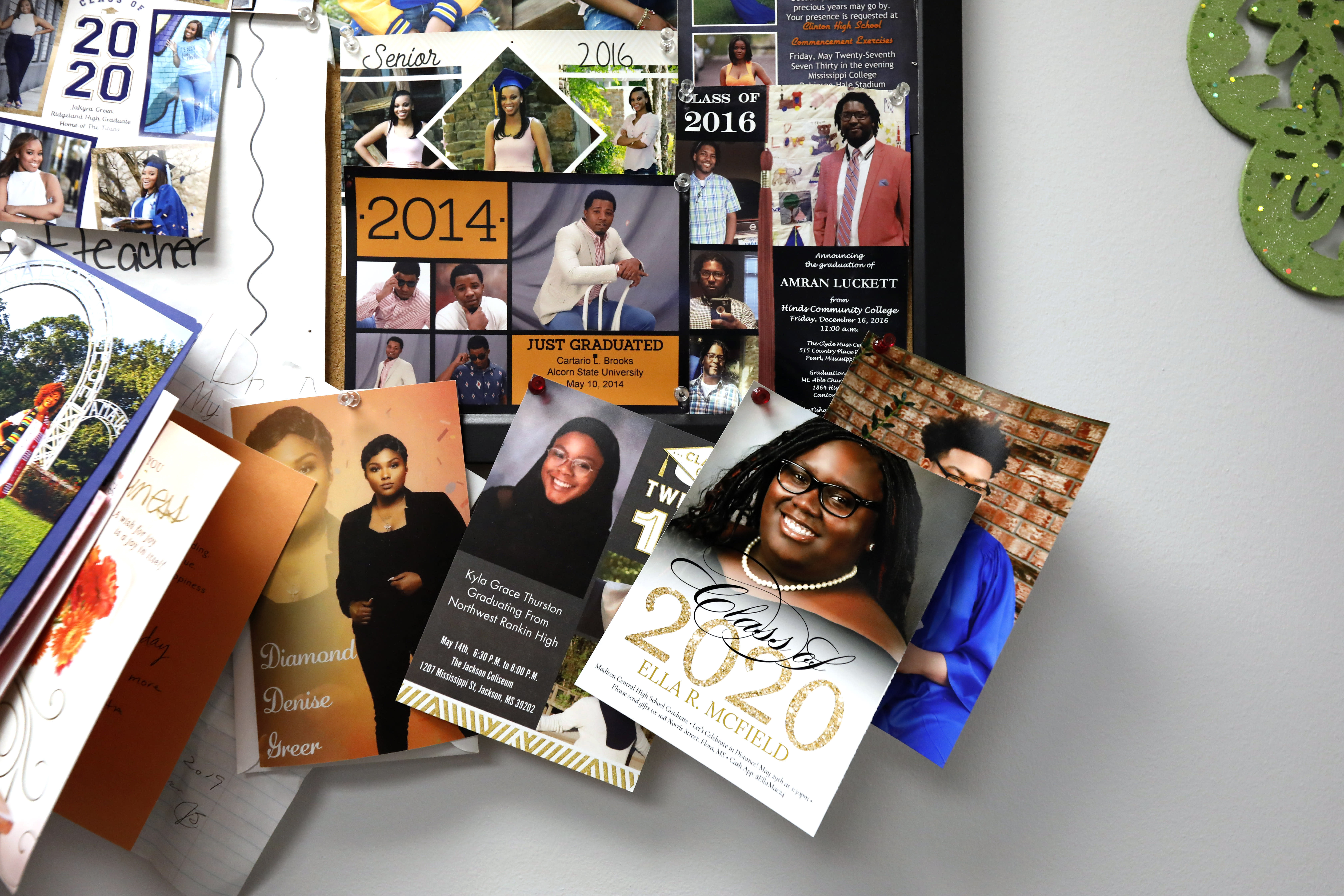 Dr. Janice Bacon's bulletin board at the Community Health Care Center on the campus of Tougaloo College is covered with senior pictures and high school graduation invitations Aug. 14, 2020, in Tougaloo, Miss. As a Black primary care physician, Bacon has created a safe space for her Black patients during the coronavirus pandemic. (AP Photo/Rogelio V. Solis)
