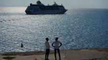 Royal Caribbean cancels 18 cruises, warns coronavirus hit to yearly profit